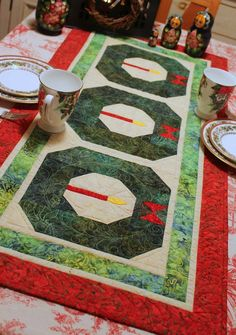 Christmas Wreath quilted table runner by Wendy Sheppard, in the December 2014 issue of UK's Popular Patchwork magazine.