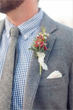 a little rustic flare boutonnier tied with a delicate lace wrap.
