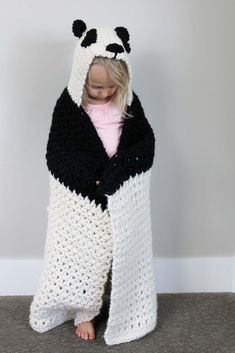 This crochet hooded baby afghan pattern will give your favorite child the chance to feel like a cozy little panda. The blanket is created first and then hood is added after, requiring only one simple seam at the top of the hood. The size and weight of this hooded afghan makes it great for kids approximately 1.5-5 years old.This panda works up quickly in chunky yarn. Customize to make a crochet koala or polar bear too--the possibilities are endless!