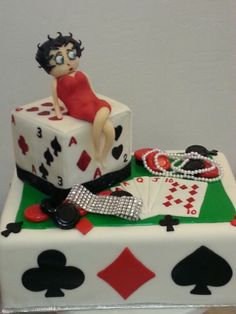 Betty Boop poker cake with modeling chocolate figure,  cards and poker chips.