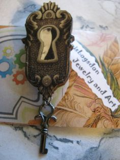Keyhole Wood Brooch with face by jansbeads on Etsy, $11.50