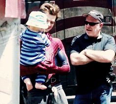 Andrew Garfield Cuddles A Baby While Being Spiderman