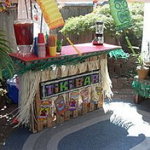 How to build a tiki bar from upcycled pallets. This project took the builder about an hour, making it a cheap and easy party decoration for a summer luau or backyard BBQ. You can make it as sleek or as tiki tacky as you want, and with such little investment in time and energy, break it down afterward.