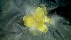 This is another example of the small lilly centerpieces that I made some of the reception tables, but this one is yellow. I also got these on clearance at Michaels and removed unwanted greenery and added silver mesh and feathers.