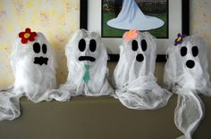 Recycled soda bottle ghosts. #halloween