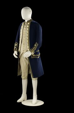 Full dress frock of a Captain. The frock is of blue wool with button back lapels faced with white and edged with gold lace. Although it is possible to wear the coat with the lapels partially buttoned across the chest, there are also three hook and eye fastenings so that the coat can be closed without unbuttoning the lapels. The skirts are not as full as those of the late 1740s. circa 1774, National Maritime Museum, Greenwich
