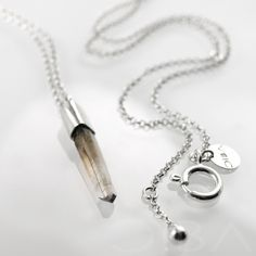 0134  A simple, minimalist silver necklece with intriguing, smoke quartz. The stone is framed in satinated silver and the chain and clasp are polished. Entirely hand made.  $98.45 Click to see details!