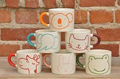 Animal Mugs. (Not for little kids - because they're ceramic.  But super cute for older ones.)
