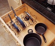 Drawers and Pullouts-shallow frying pans, saute pans, and lids easy to access (rather than stacked in an unwieldy pile), store them in a wire rack inside a deep drawer.