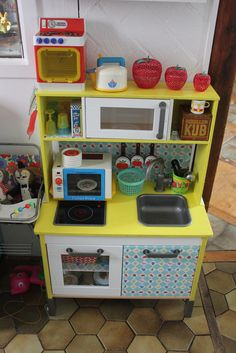 IKEA play kitchen hack :: LOVE all that fun color! Play Kitchen Diy, Ikea Kids Kitchen, Play Kitchens, Ikea Childrens Kitchen, Duktig, Ikea Toys, Deco Kids, Vintage Kitchen, Diy For Kids