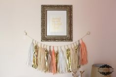 We LOVE that we're seeing the tassel garlands in the nursery! #pinkandgold