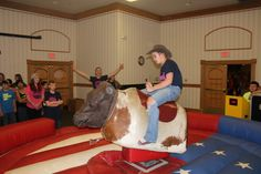 #8 - Riding the Mechanical Bull during Western Convention at North Platte in November