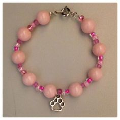 A personal favorite from my Etsy shop https://www.etsy.com/listing/467784632/paw-print-bracelet
