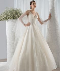 This romantic Beaded tulle A-line gown features a V-neckline, low v-back and Chapel length train www.uniquebridalandboutique.com