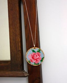 Cross stitch rose pendant. All I need is the cardboard / plastic circle beneath and it's a done deal.