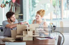 Stock Photo : People building model together