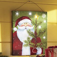 Lighted Santa Wall Canvas from Through the Country Door® Christmas Wood, Christmas Signs, Christmas Pictures, Christmas Projects, Holiday Crafts, Christmas Wreaths, Christmas Decorations, Christmas Ornaments, Xmas