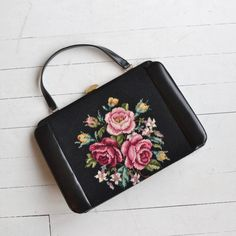 Vintage 1960s large black leather and black rose needlepoint handbag, seemed never used with vinyl interior that includes a change purse. --- M E A S