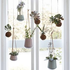 Set Of Two Hanging Ceramic Planters With Leather Straps