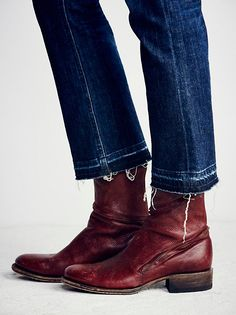 Essential Zipper Ankle Boot | Leather ankle boots featuring a twisted zip design along the shaft and heel. Rounded toe and stacked heel. Distressing throughout gives way to a worn-in look.