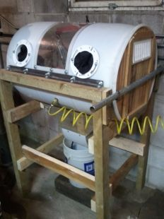 Sandblasting Cabinet - Homemade sandblasting cabinet constructed from a steel drum, lumber, angle iron, plexiglass, pneumatic fittings, CFL lighting, air hoses, and grills.