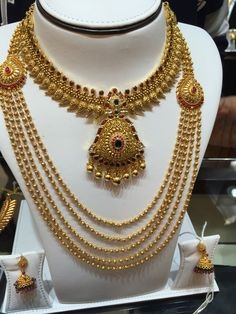 Manga necklace and Gold pearl haram .GRT Jewellers