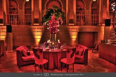 Tower of Freedom roses, pink phalaenopsis orchids and elephant ?ear leaves presented on a base of submerged red tulips #GOWS #platinumlist #weddingstyle #graceormonde #luxuryweddings