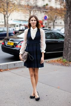 Always inspiring Alexa layers a sheer button up under a pinafore style striped dress.  The bow flats are a perfect compliment.