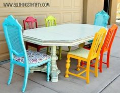 Love the idea of mismatched old chairs painted different colors with bright, happy fabric for the Craft Room.