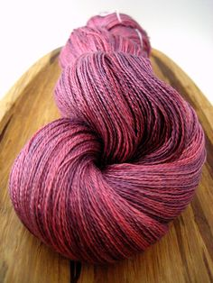 Silk lace - Rasberry Wine, hand-dyed, 100% silk 2-ply 1094 yds. $40.00 USD, via Etsy.