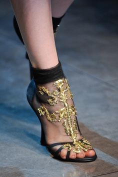Dolce & Gabbana. gold intricate detailing. socks and heels. enclosed sandal pumps. womens fashion. womens outfit ideas. womens high heel shoes.