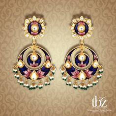 Add an instant classic appeal to your persona with these traditional blue Chandbalis with pink detailing and pearls.