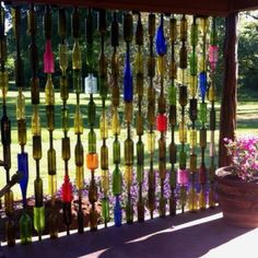 Bottle fence. Drill a hole through bottom of bottle and put through rebar. Beautiful when light hits it!