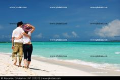 http://www.photaki.com/picture-young-couple-on-the-beach-youth-women_320322.htm