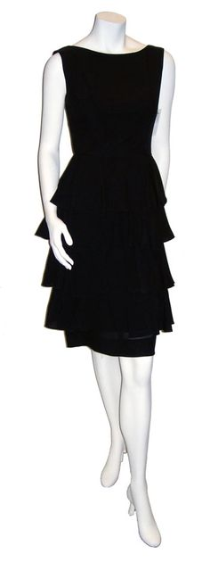 """$79.00  Decades continues to salute the ubiquitous Little Black Dress. This particular dress is 100% rayon and features 4 tiers of beautiful ruffles from waist to hem. There is no label on this one. I put the size at a modern true size 4 as it measures 25"""" at the waist. Condition as with most things Decades sells is a 10 out of 10. Drop in the shop when you're downtown to try this fabulous and stylish dress on!"""
