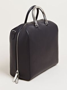 I really don't like bags that don't have a lot of inside structure, but this is just too pretty! It looks like an updated, old suitcase women and men use to carry around. (or a dr.bag, but shhh) - Maison Martin Margiela