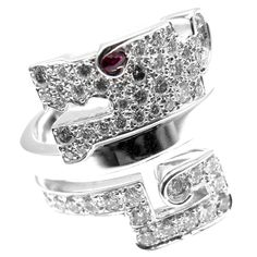 Cartier Le Baiser Du Dragon Ruby Diamond Gold Ring   From a unique collection of vintage cocktail rings at https://www.1stdibs.com/jewelry/rings/cocktail-rings/