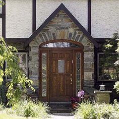 The broad arch of the door frame contrasts the steeply gabled entrance and vertical lines of the Tudor ... & English Tudor Style Entryway | ... style door in new addition to ... pezcame.com