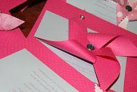 pinwheel on invitation made out of ribbon!