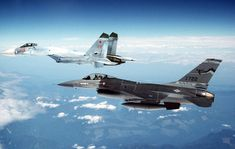 An Fighting Falcon aircraft from the Fighter Interceptor Squadron, Montana Air National Guard, escorts a Soviet Flanker aircraft to the Canadian border after an air show. Finnish Air Force, Russian Air Force, Air Force Aircraft, Fighter Aircraft, Area 51, Russian Fighter Jets, Russian Bombers, Jet Fly, Sky Sea