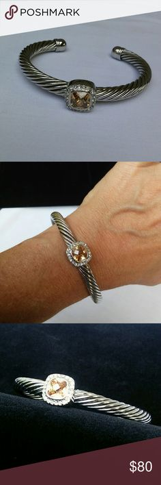 Gorgeous Morganite Cuff Bracelet This bracelet is like new, never worn. Given to me as a gift, it has a thick silver plated twisted band crowned by a square cut lab created morganite surrounded by cubic zirconia. Finished with smooth ball tipped ends, this bracelet is modern, classy and a well made pics of jewelry. It reminds me of David Yurman styles. But I believe it is by Lenox. Unmarked. High quality Jewelry Bracelets