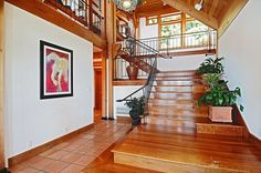 Craftsman Staircase with Hardwood floors, Loft, Floating staircase, High ceiling, Pendant light