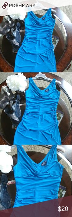 American Living teal Dress Gorgeous Teal dress with scrunched waist for tummy tuck . size 6 but can fit up to a perfect 10;) American Living Dresses
