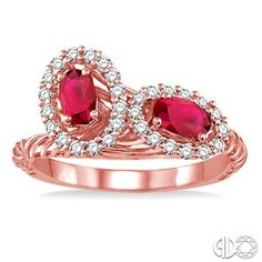 Beautifully Rendered On 14 Karat Pink Gold This Modish Frame Ring Is Exquisitely Adorn With Two Oval Cut Ruby Nestled Among 30 Pave And Prong Set Round Accents Diamonds That Creates Halo And The Shank Is Embellished With The Filigree Designed. Total Diamond Weight Is 1/3 Ctw And Each Oval Cut Ruby Measures 5x3 MM.