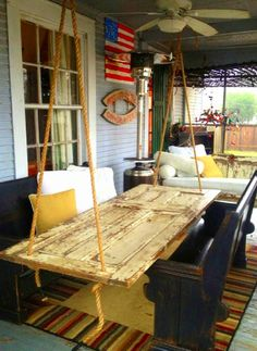 Hanging patio table. Brilliant! ... need a roof for my deck?  maybe next year... maybe living room now?