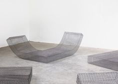 Belgian design studio Muller van Severen has crafted curving loungers from wire netting as part of a furniture commission for the Solo Houses