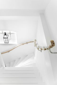 TOUR AROUND OUR HOME: HANDRAIL MADE OF BRANCHES | THE STYLE FILES http://style-files.com/2014/12/16/tour-around-our-home-handrail-made-of-branches/
