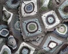 Grey Circle in a square grannies. No pattern but lovely colour combination.More on flickr.