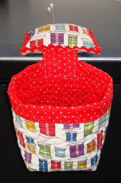 Thread catcher for next to sewing machine; pincushion weighted with rice sits on table and bin dangles below