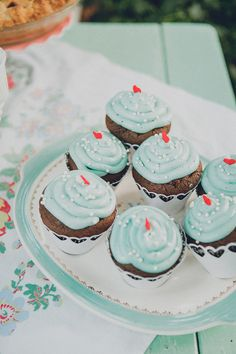 teal cupcakes with red heart toppers // photo by Jaquilyn Shumate